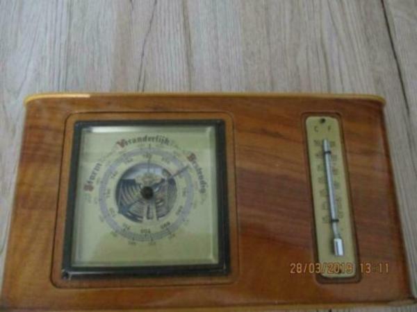 Scheepsbarometer en temperatuur meter