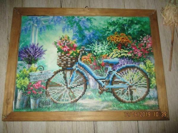 Apart schilderij van kraaltjes over fietsen