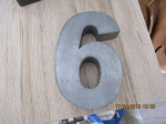huis nummers  6  van gietijzer en 7 en 8 van keramiek